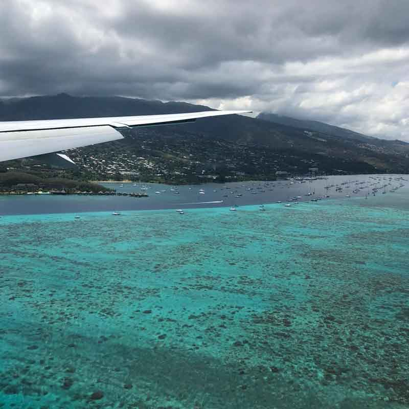 speur-aviation-plane-flying-over-sea-and-mountains
