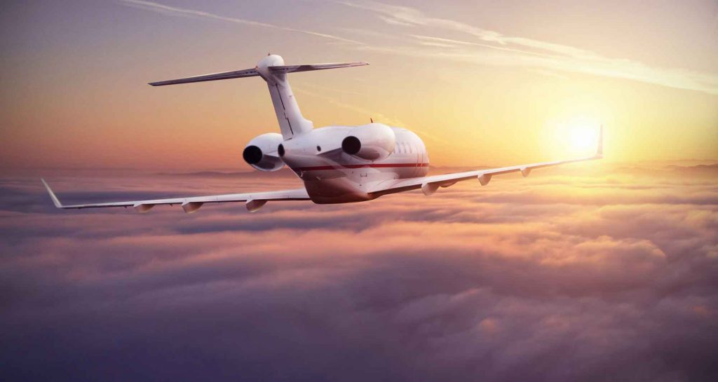 Speurviation-DefaPrivate-jet-plane-flying-above-clouds-in-beautiful-sunset-light.-Modern-and-fastest-mode-of-transportation,-business-life